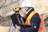A land surveyor using an altometer