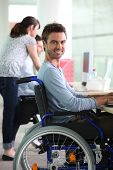 Man in wheelchair at work