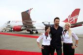 LOS ANGELES - SEPT 23:  Hugh Jackman with Virgin America flight attendants arrives as Virgin America unveils new DreamWorks 'Reel Steel' plane at LAX Airport on September 23, 2011 in Los Angeles, CA