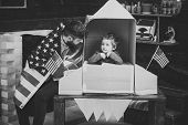 Rocket Launch Concept. Kid Happy Sit In Hand Made Rocket With Usa Flags. Child Cute Boy Play Cosmona poster