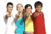 Happy Group Of Diverse Teenagers Pointing