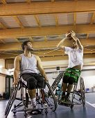 Disabled Sport Men In Action While Playing Indoor Basketball poster