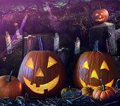 Halloween pumpkins in a grave yard