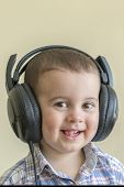 Beautiful Baby Boy In Big Headphones. A Boy In A Plaid Shirt Listening To Music. Toddler Boy In Blac poster