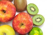 a few apples, tangerines and kiwis on a white background