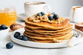 American Pancakes With Blueberries, Walnuts, Honey. Healthy Breakfast Pancakes. Homemade Pancakes. C poster