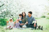 Happy Big Family Mom Dad And Children Daughters And Son Having Fun Outdoor In Park Smiling And Laugh poster