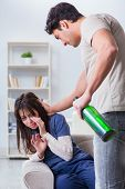 Drunk husband abusing wife in domestic violence concept poster