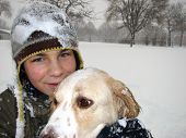 Boy And Dog In The Snow
