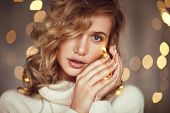 Beautiful Young Blond Girl In Sweater Holding Golden Garland And Looking Sensually At Camera. poster