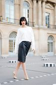 Fashion Model In White Blouse And Leather Skirt. Woman With Red Lips Makeup In Paris, France. Sensua poster