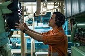 Marine Engineer Inspecting Ships Engine In Engine Control Room poster