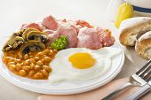 English Cooked Breakfast - English Breakfast Of Bacon, Egg, Baked Beans And Mushrooms. poster