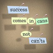 Success Comes in Cans Not Can'ts Saying on Paper Pieces Pinned to a Cork Board, a positive motivatio