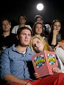 picture of movie theater  - Young couple on a date at the movie theater - JPG