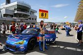 SEPANG - JUNE 10: A grid girl poses with the Subaru BRZ GT300 car of the R&D Sport Team on the start