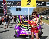 SEPANG - JUNE 10: A grid girl poses with the Shiden MC/RT-16 car of Cars Tokai Dream28 on the start