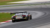 SEPANG - JUNE 9: The Audi R8 LMS car of the Gainer Team seen from the rear takes turn 5 at the 2012 Autobacs SUPER GT Series Round 3 on June 9, 2012 at the Sepang International Circuit, Malaysia.