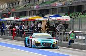 SEPANG - JUNE 9: The Audi R8 LMS car from APR team runs down the pit lane after a tire change at the