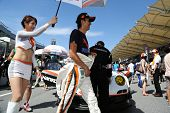SEPANG - JUNE 10: A grid girl shades driver Tomonobu Fujii of Hankook KTR at the start grid at the 2