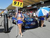 SEPANG - JUNE 10: A grid girl poses in front of a Porsche 911 car of Team Taisan Endless on the star