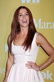 LOS ANGELES - JUN 12:  Poppy Montgomery arrives at the City of Hope's Music And Entertainment Industry Group Honors Bob Pittman Event at Beverly Hilton Hotel on June 12, 2012 in Beverly Hills, CA