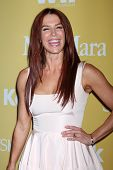 LOS ANGELES - JUN 12:  Poppy Montgomery arrives at the City of Hope's Music And Entertainment Indust