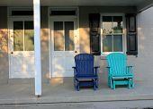 Two blue adirondack chairs