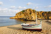 Traditional Old Wooden Fishing Boat On The Rocky Beach. Travel Concept. Costa Brava, Spain. Fishing  poster