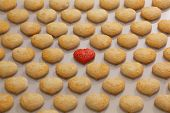 Many Identical Cookies On The Table, One Cookie Is Differentю One Red Cookie Among Many Identical. L poster