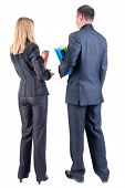 picture of youg  - Back view of  business team look into distance - JPG
