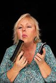 Mature Blonde Woman With Cell Phone And A Handgun (6)