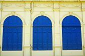 Blue door and yellow walls.