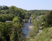 stock photo of swales  - A view from the caste at richmond of a bridge over the river swale - JPG