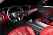 Red Luxury Modern Car Interior With Steering Wheel, Shift Lever And Dashboard. Clipping Path. Detail poster