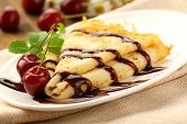 image of crepes  - Sweet pancake with chocolate sauce and cherries - JPG