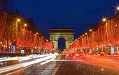 The Triumphal Arch And Champs Elysees Avenue Illuminated For Christmas 2019 , Paris, France. poster