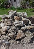 A Pile Of Large Mica And Quartz Rocks Stacked In A Pile In The Sunshine In South Dakota. poster
