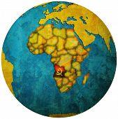 Angola Flag On Globe Map