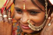 stock photo of rajasthani  - Portrait of a smiling India Rajasthani woman - JPG