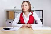 Friendly female Human Resource manager doing job interviews at her desk
