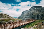 Trollstigen, Andalsnes, Norway. People Tourists Walking Visiting Viewing Platform Near Visitor Centr poster