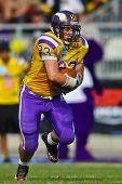 VIENNA, AUSTRIA - JUNE 12 RB Florian Hiess (#23 Vikings) runs with the ball on June 12, 2011 in Vienna, Austria. The Vienna Vikings beat the Graz Giants 19:14.