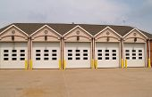 stock photo of firehouse  - row of garage doors for a firehouse with doors closed - JPG
