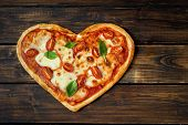 Delicious Heart Shaped Italian Pizza On Wooden Background poster