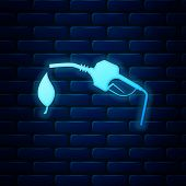 Glowing Neon Bio Fuel Concept With Fueling Nozzle And Leaf Icon Isolated On Brick Wall Background. N poster