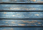 Old Wooden Planks Background With Shriveled Blue Paint. Blue Wood Backdrop. Rustic Aged Wooden Table poster