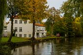 Odense, Denmark: Beautiful Old Buildings By The River In Odense. poster