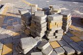 Gray Stone Paving Slabs Piled Pile For Paving The Pedestrian Sidewalk, Closeup Of Building Materials poster