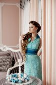 Fashion rich woman in luxury interior